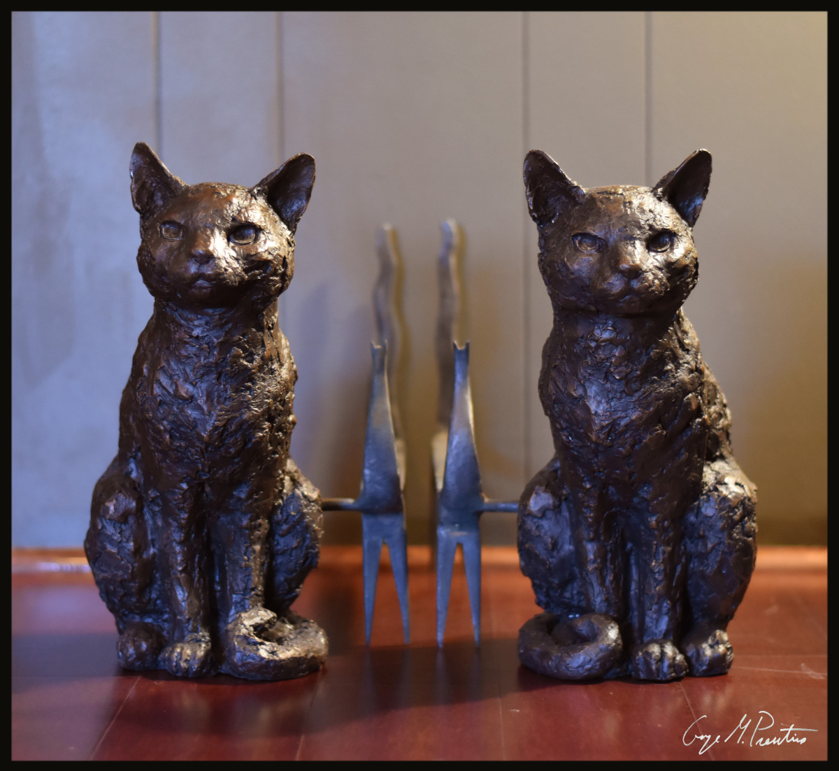 Life Size bronze cats used as andirons in fireplace